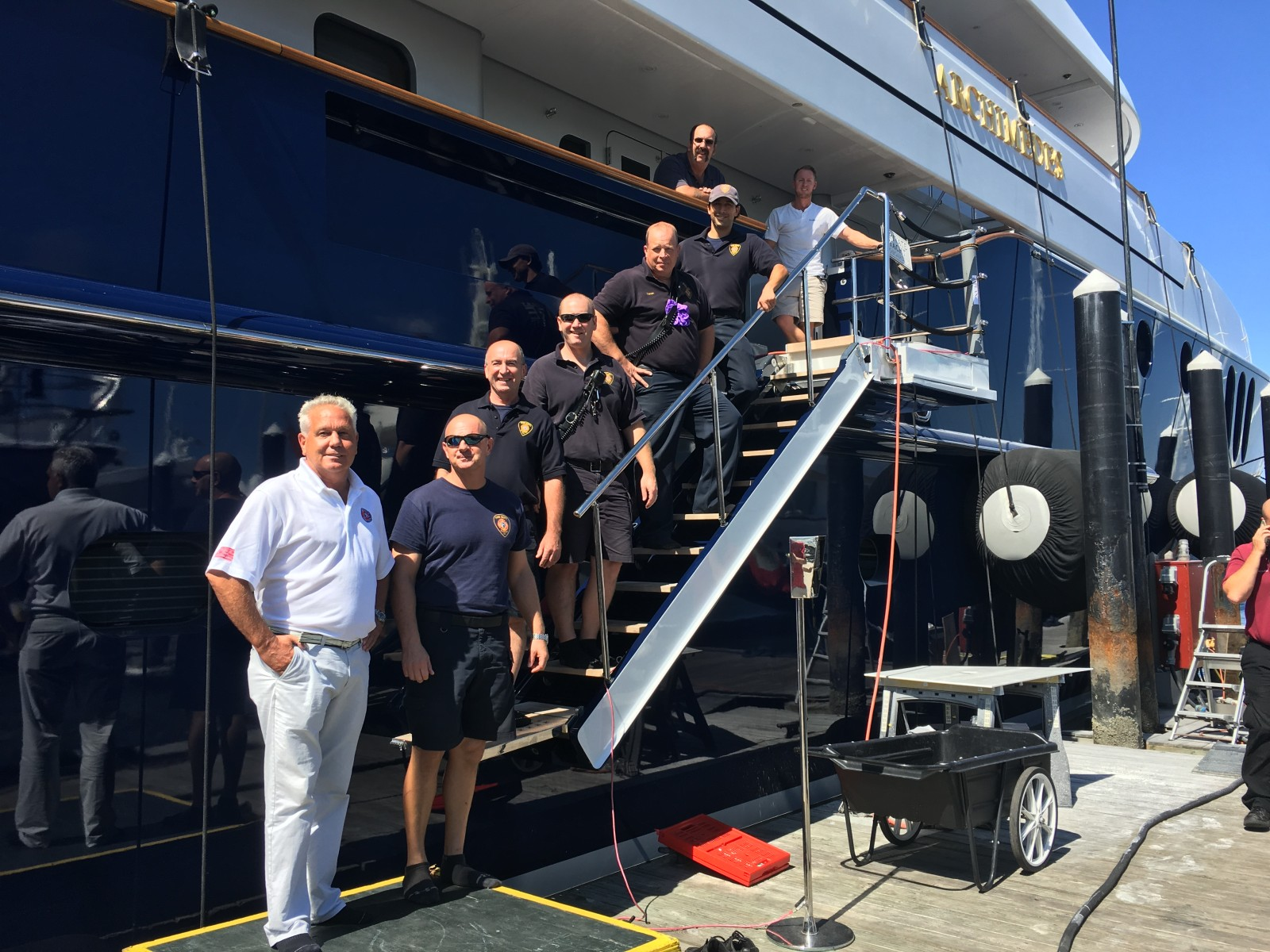Bosun Max Haynes (at top of gangway) leads firefighters from the Newport Rhode Island Fire Department through M/Y Archimedes at Newport Shipyard in September. PHOTOS FROM AIG PRIVATE CLIENT GROUP