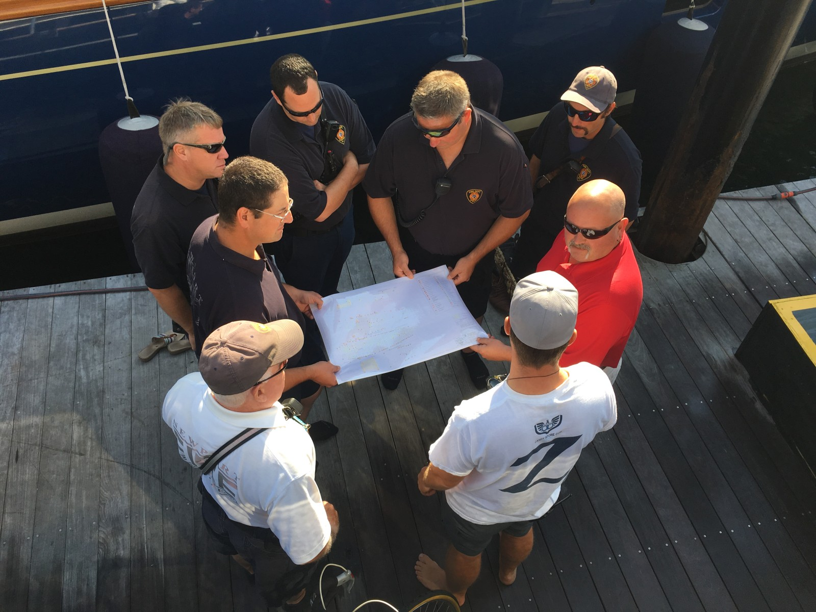 Newport Rhode Island firefighters examine S/Y Zenji's fire plan. PHOTOS FROM AIG PRIVATE CLIENT GROUP