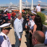 World record sailing champion Marc Pajot 5 talks with Taape French national Navy supply ship's captain during today's 16th Yachts du Coeur in Cannes. PHOTO PROVIDED