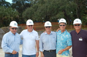 Capt. Bill Zinser, far right, posed with other veteran captains at the groundbreaking of Quantum Marine's new building last November. Quantum owner John Allen, center, was also honored by ISS Wednesday night. FILE PHOTO