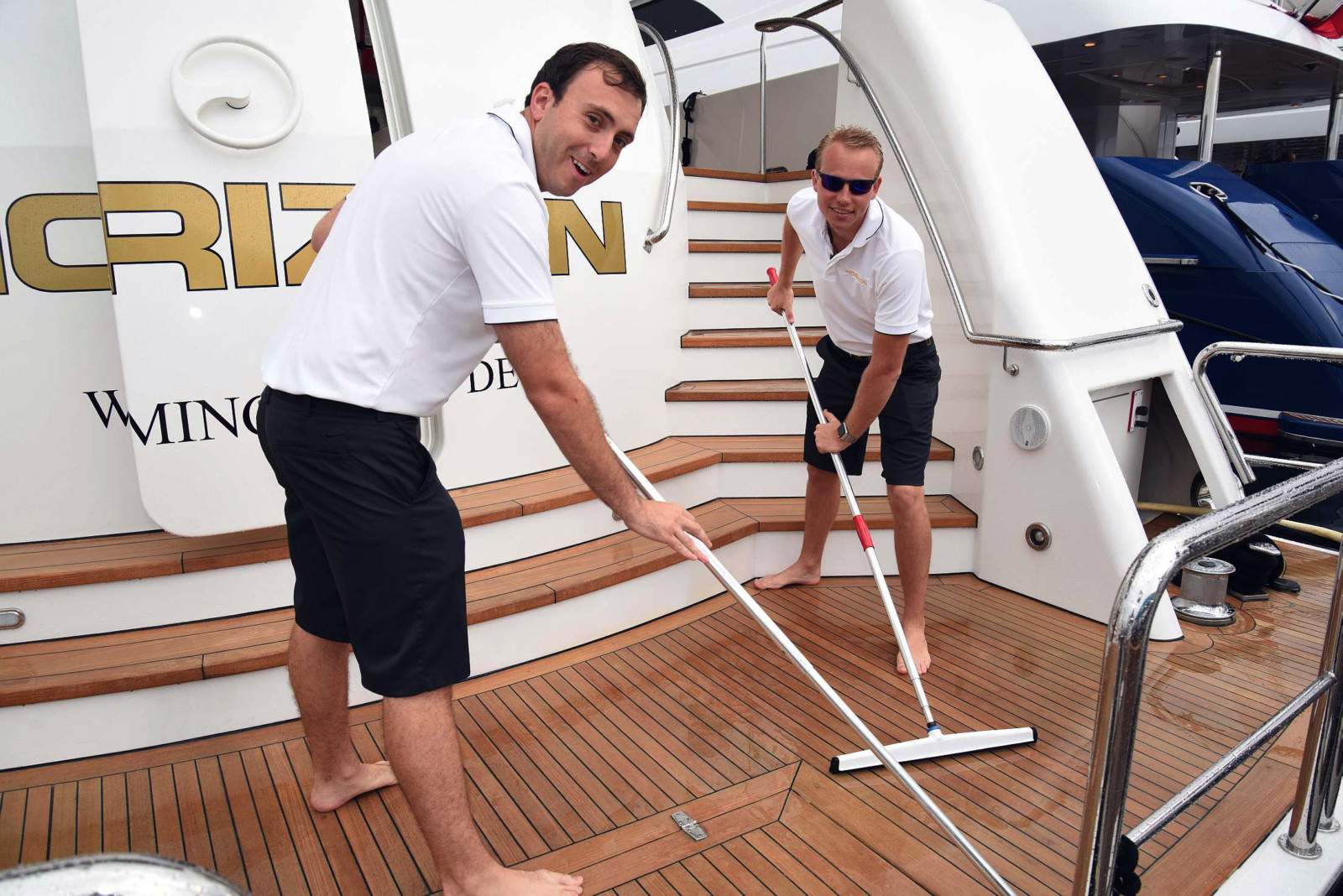 Crew work with a smile, rain or shine at Fort Lauderdale International Boat Show