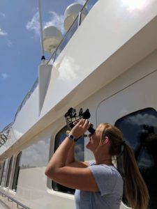Creative yacht crew view partial solar eclipse in Florida