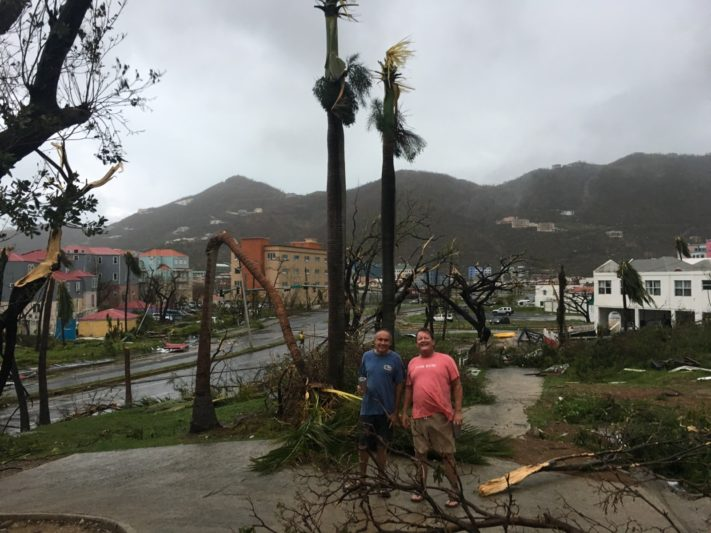 Windowless cars, damaged boats, rare flights aid Tortola escape after Hurricane Irma