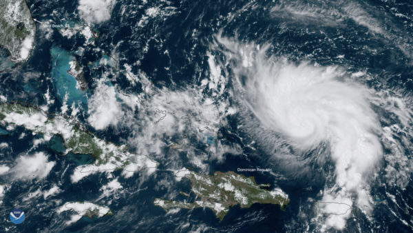 Second weather system 'steered', stalled Dorian