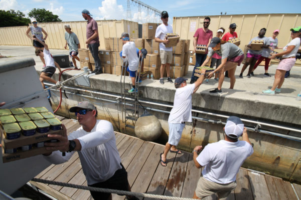 Box by box, volunteers fill Mission of Hope's boat for Hurricane Dorian relief