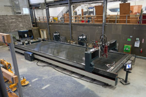 New waterjet cutting machine operational at Maine yard