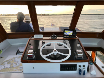 The past comes roaring back at the helm of a vintage Huckins motor yacht